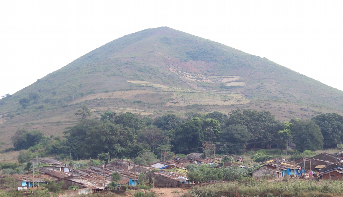 A village nestling on the foot hill of a denuded hill under shifting cultivation.JPG